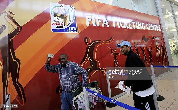 A man shows his Identity card he needs to purchase official 2010 FIFA World Cup tickets on April 15 2010 at the Maponya shopping mall in Soweto...
