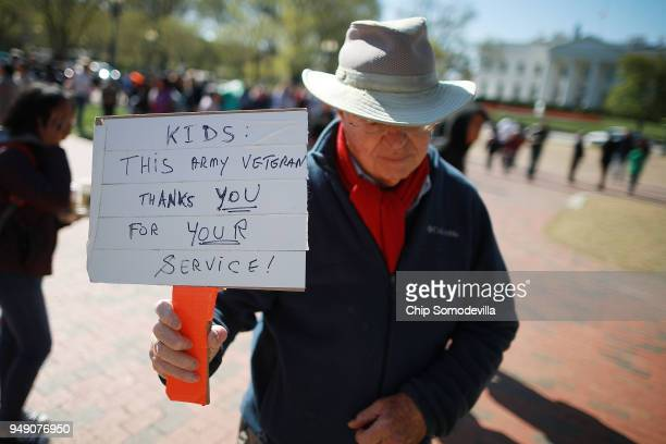Man shows his support for several hundred high school students from the Washington area as they rallying in front of the White House to protest...