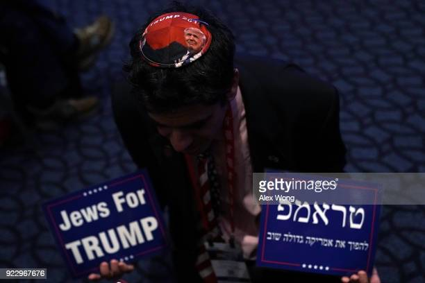 A man shows his Trump yarmulke to photographers prior to the opening of CPAC 2018 February 22 2018 in National Harbor Maryland The American...