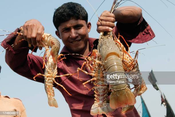COX'S BAZAR BEACH BANGLADESH A man shows lobsters caught off the Cox's Bazar beach