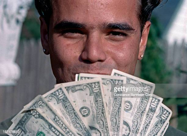 A man shows off his cash pay for a job well done New York State 1965
