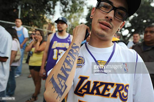 A man shows off his Los Angeles Lakers tattoo as fans await the start of the Lakers victory parade celebrating their 2009 NBA championship in...