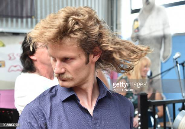 A man shows off his mullet haircut at Mulletfest 2018 in the town of Kurri Kurri 150 kms north of Sydney on February 24 2018 Mulletfest is a...