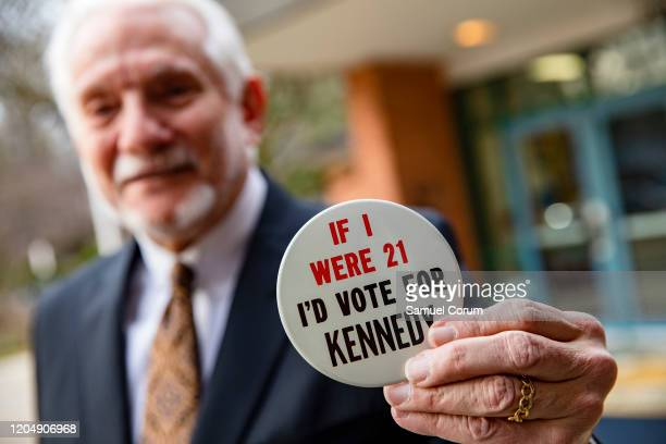 A man shows off his political button that says If I were 21 Id vote for Kennedy outside of the Taylor Elementary School after casting his ballot in...