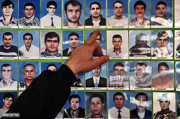 Man shows on April 11, 2015 miners who died at a miners' association near Soma at Savastepe in Manisa. Dozens of suspects will stand trial on April...