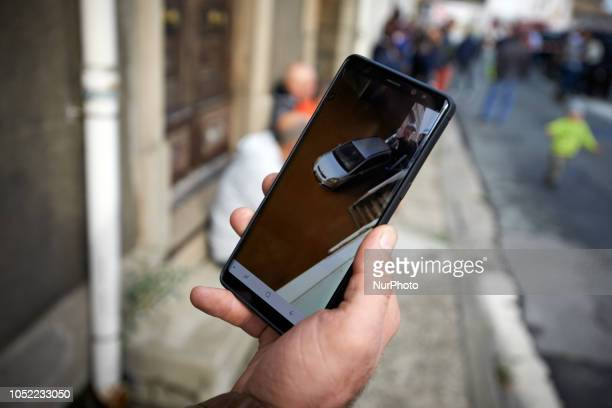 A man shows on his smartphone a video of the flooding in Trèbes Flash floods swamped towns and villages around the fortress city of Carcassonne in...