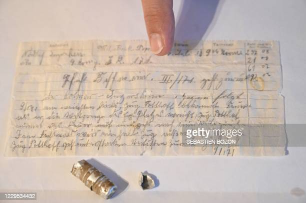 Man shows on November 8 in Munster, eastern France, a message probably lost by a carrier pigeon in 1910, sent by a German officer and miraculously...