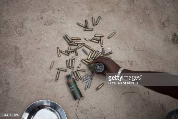A man shows shell casings of bullets fired by the UN peacekeeping force MINUSCA and Central African troops in front of the base of Nimery Matar...