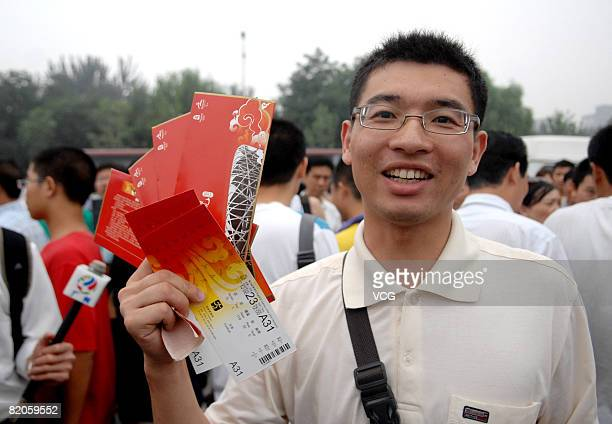 A man shows the olympic tickets he has just bought in the ticket sale booth in Beijing Olympic Center on July 25 2008 in Beijing China The final...