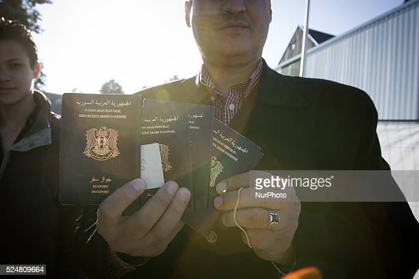 VOORSCHOTEN A man shows the passports of his family whom he fled with from Syria His wife is currently still lilving in his hometown of Homs His...