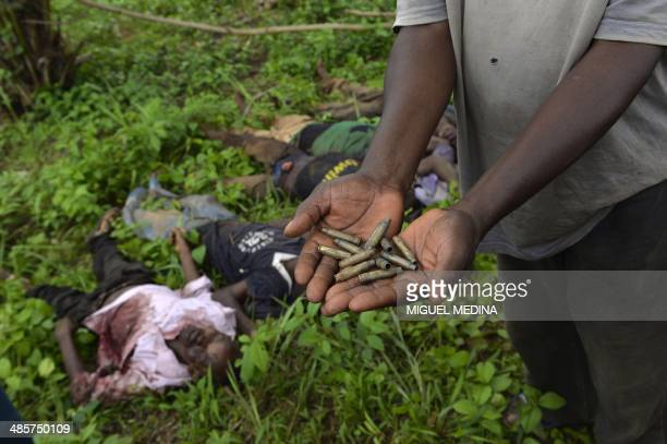 A man shows the spent bullet casings found near the bodies of five people three AntiBalaka fighters and two presumed civilians who were killed during...