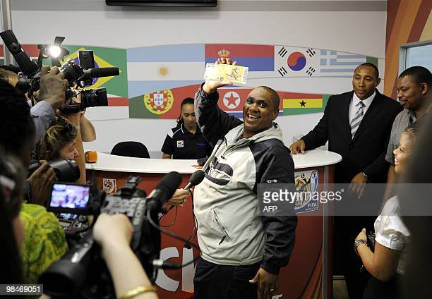 A man shows to the media the official 2010 FIFA World Cup ticket he just purchased on April 15 2010 at the Maponya shopping mall in Soweto on the...