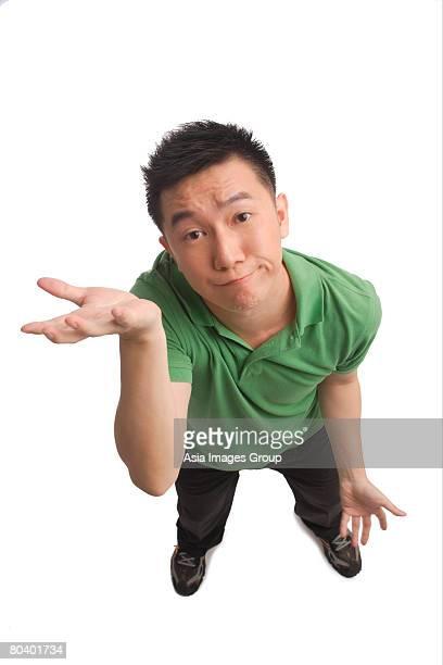 Man shrugging while looking at camera