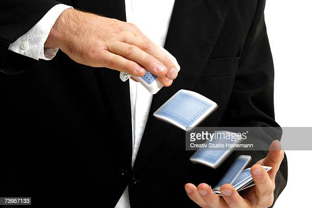 man shuffling deck of cards, close-up, mid section - shuffling stock photos and pictures