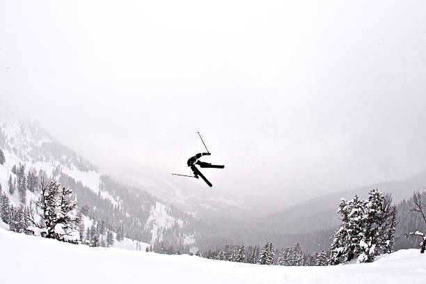 A man sideways in the air on Teton Pass, Wyoming.