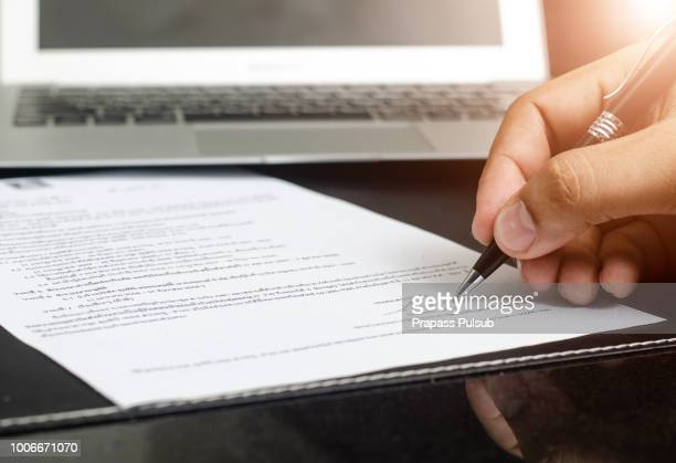 man signing contract. close up. deal concept - employment law stock photos and pictures