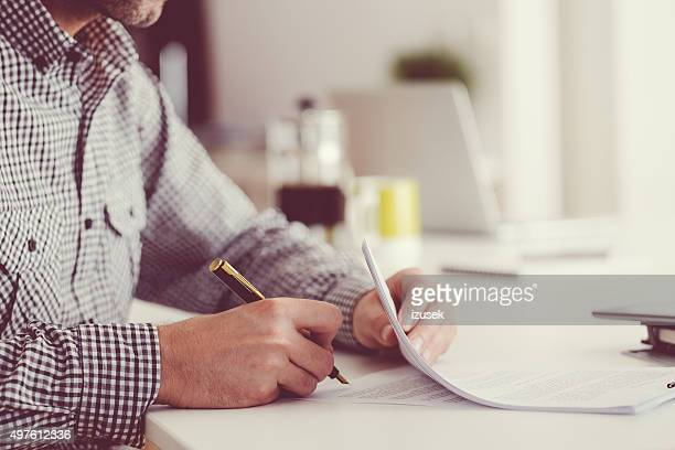 man signing documents, unrecognizable person - signature stock photos and pictures