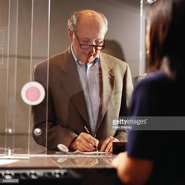 Man Signing His Signature for Identification
