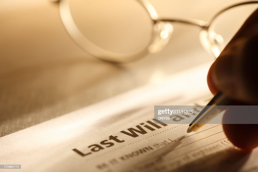 Man signing last will and testament : Stock Photo