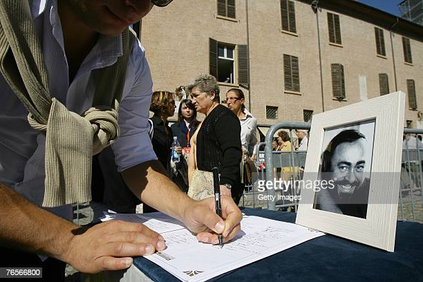 A man signs a book of condolence at the entrance of Modena's Duomo where the coffin of Maestro Luciano Pavarotti lies in state on September 07 2007...