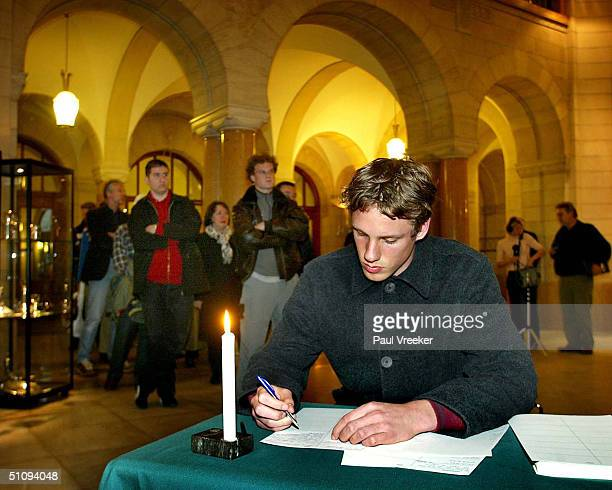 A Man Signs A Condolence Register After The Murder Of Controversial Dutch RightWing Politician Pim Fortuyn May 6 2002 At City Hall In Rotterdam...