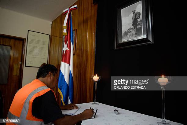 A man signs the condolence book at the Cuban embassy in Guatemala City on November 28 two days after the demise of Cuban leader Fidel Castro Hundreds...