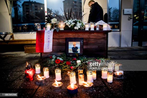 Man signs the condolences book at a makeshift memorial for Swedish pop singer and songwriter Marie Fredriksson outside Baggpipe Studios in...