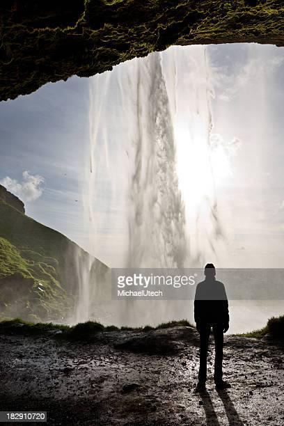 Man Silhouette Behind Waterfall