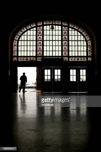 man silhouette in haydarpasa train station - haydarpasa stock photos and pictures