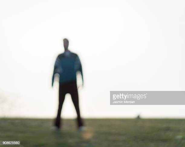 man silhouette out of focus - stranger stock pictures, royalty-free photos & images