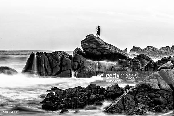 Man silhuetted against the horizon in a seascape