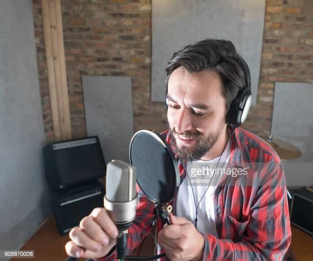 Man singing at a music studio