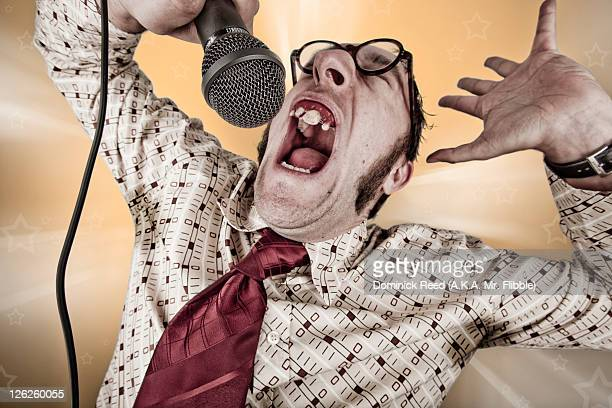 man singing badly into microphone - ugly teeth stock photos and pictures