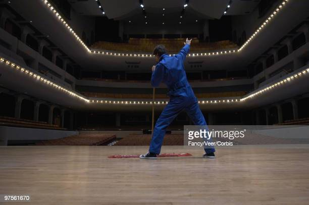 Man singing in an empty theater