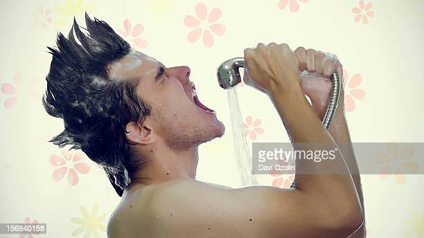 Man singing in the shower with a mohawk