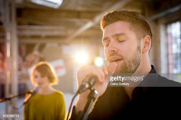 Man singing into microphone
