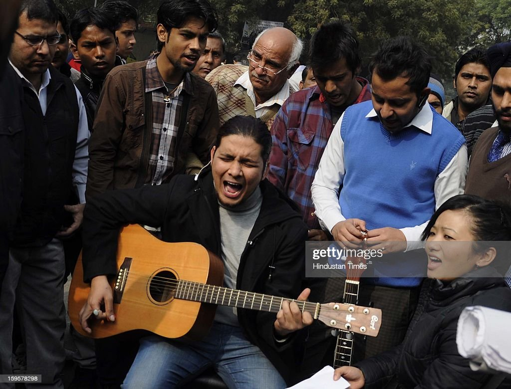 A man sings and plays the guitar during the protest against the alleged inaction by the Indian government regarding the gang rape of a 23-years old student in a bus a month ago, on January 16, 2013 in New Delhi, India. The bus rape has drawn protests and intense media attention. Rapes have become front-page news nearly every day across the country, with demands that police do more to protect women and that the courts treat sexual violence seriously.