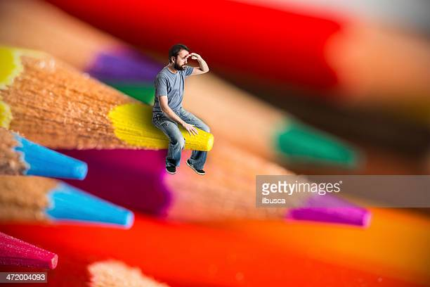 Man sit on crayons looking out