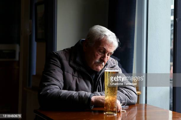 Man sits alone in The Churchgate pub with a pint as indoor hospitality reopens on May 17, 2021 in Bolton, England. UK Health Secretary Matt Hancock...