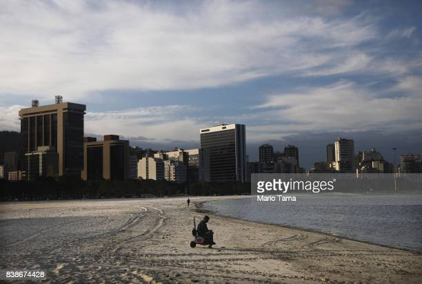 A man sits along polluted and often abandoned Botafogo beach on August 24 2017 in Rio de Janeiro Brazil A study by Folha stated that three in ten...