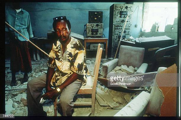 A man sits among the wreckage in Radio Mogadishu after the US helicopter attack December 6 1993 in Mogadishu Somalia US gunships attacked the...
