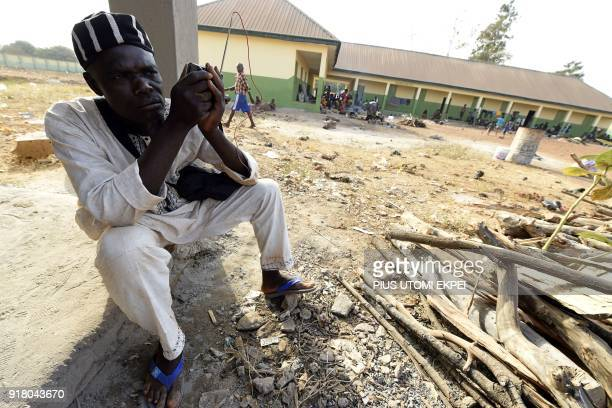 A man sits as he listens to the radio at the internally displaced people camp occupied largely by women and children affected by herders and farmer's...
