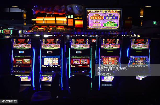 A man sits at a poker machine in the gaming room at the Vikings Club in Canberra Australia on Monday Sept 26 2016 Despite having less than half a...