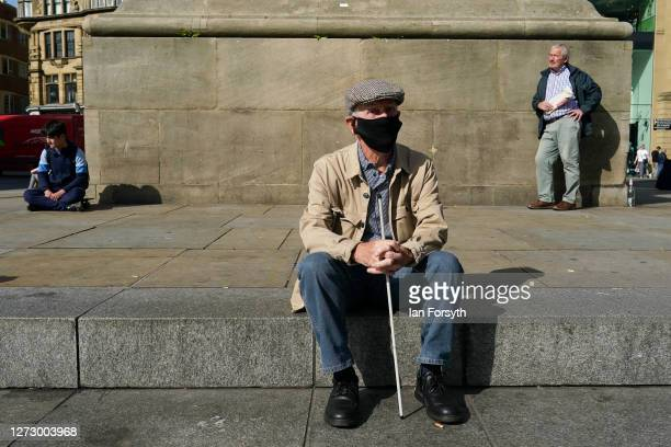 A man sits at the bottom of Grey's Monument in Newcastle on September 17 2020 in Newcastle upon Tyne England Almost two million people in northeast...