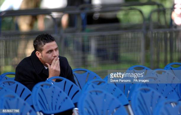 A man sits down after the unveiling of a memorial by Prince of Wales and the Duchess of Cornwall to those who died in the Bali bombings four years...