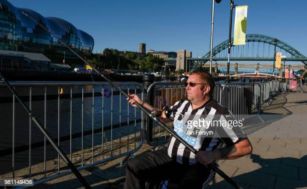 Man sits fishing by the banks of the River Tyne on the launch day of the Great Exhibition of the North on June 22, 2018 in Newcastle Upon Tyne,...