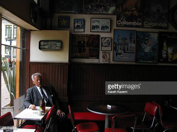 A man sits in a bar with empty bottles of beer in front of him on the table in the old part of the city Bogota formerly called Santa Fe de Bogota is...