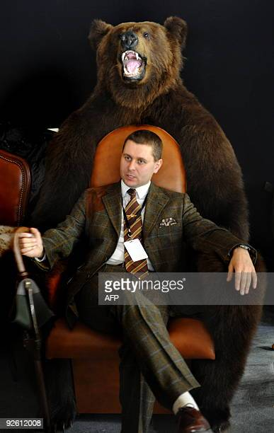 A man sits in a chair made from bearskin at the pavilion showing a luxury interior at the Moscow Millionaire Fair 2009 late on October 23 2009 AFP...
