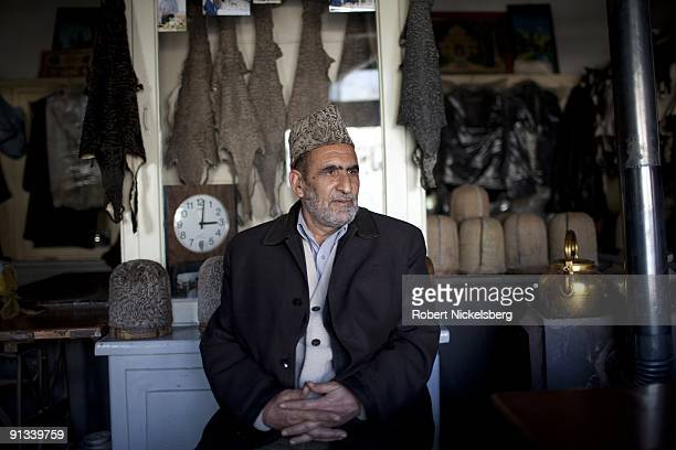 A man sits in a shop making karakol wool hats in the old city of Kabul Afghanistan March 4 2009 Kabul has an estimated population of 35 4 million...