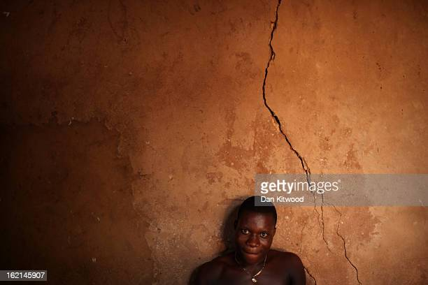 A man sits in a shrine during a Voodoo ceremony on January 8 2012 in Ouidah Benin Ouidah is Benin's Voodoo heartland and thought to be the spiritual...